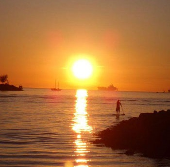 vancouver summer beach sunset paddle boarder