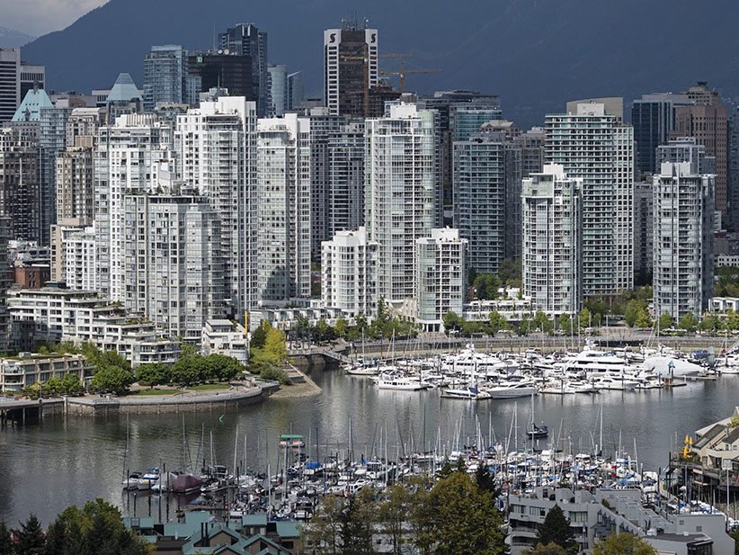 A high angle view of Vancouver's False Creek and the crowded downtown skyline, Vancouver, B.C., May 4, 2015. Bayne Stanley/CP