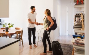 Airbnb image traveller w suitcase in suite