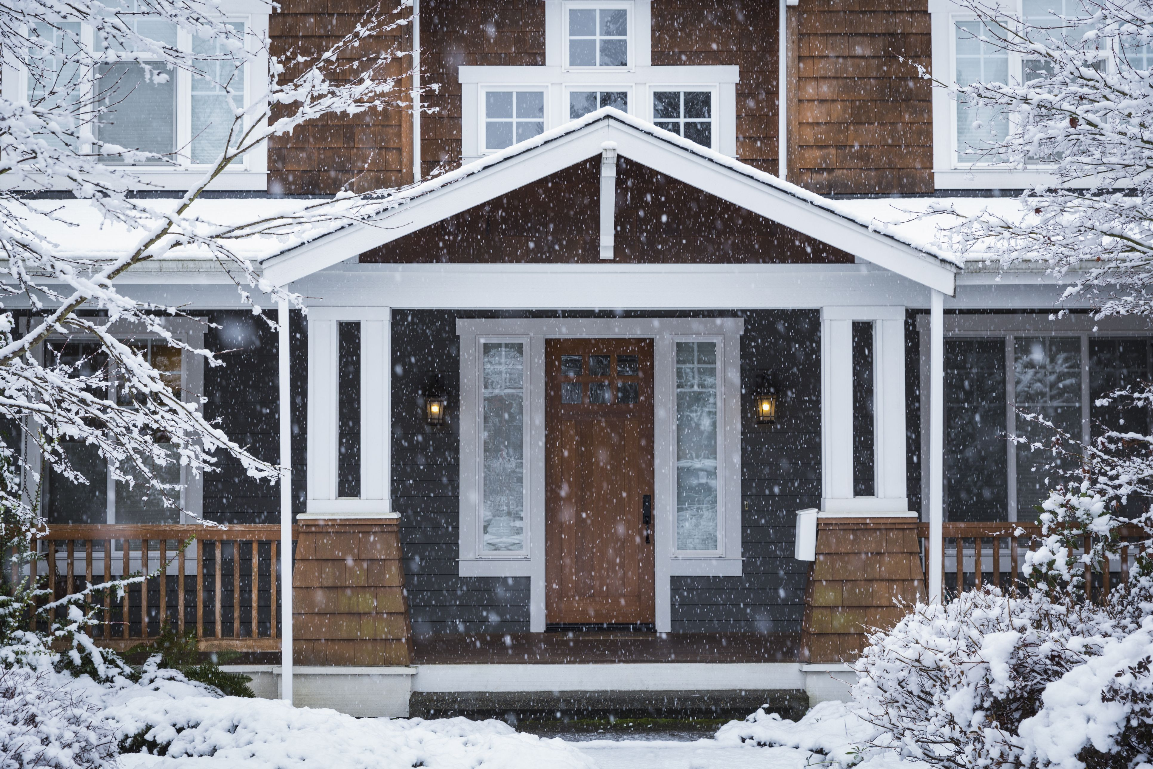 snow falling on house